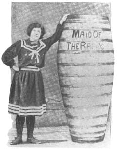 Martha Wagenfuhrer standing next to the barrel that carried her through the Whirlpool Rapids